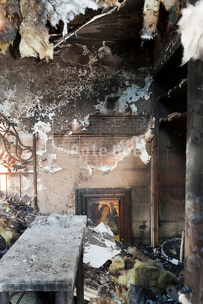 total burned out remains of room in residential house