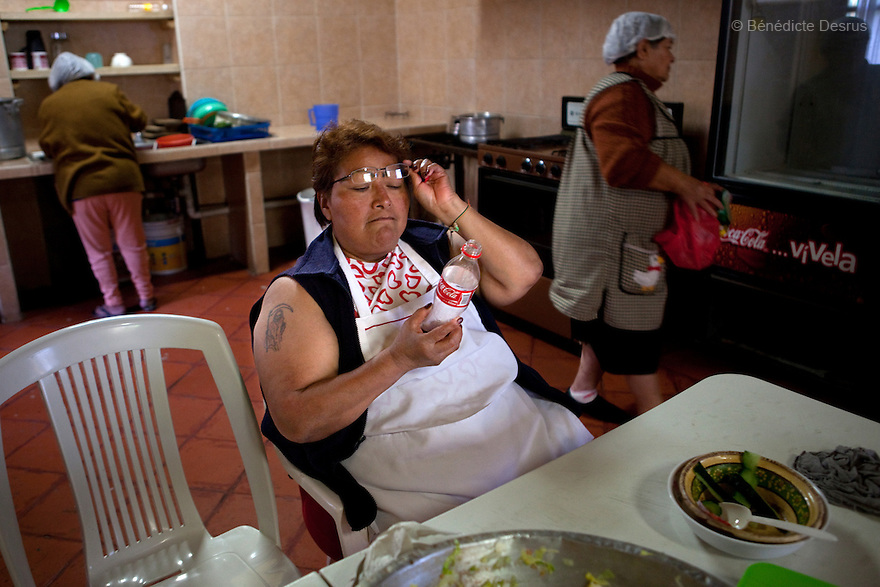 Paola, resident of Casa Xochiquetzal, during lunch time at the shelter in Mexico City, Mexico on October 4, 2010. Casa Xochiquetzal is a shelter for elderly sex workers in Mexico City. It gives the women refuge, food, health services, a space to learn about their human rights and courses to help them rediscover their self-confidence and deal with traumatic aspects of their lives. Casa Xochiquetzal provides a space to age with dignity for a group of vulnerable women who are often invisible to society at large. It is the only such shelter existing in Latin America. Photo by Bénédicte Desrus