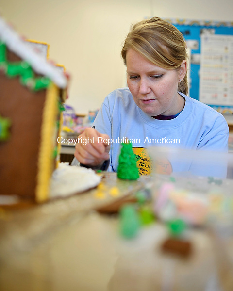 MIDDLEBURY, CT - 29 November 2012-112912EC03--  Emily Keeney decorates a Christmas tree made of sugar Thursday morning.  The Southbury woman is making a gingerbread house for the annual Gingerbread Village at St. George's Episcopal Church in Middlebury.  This year there will be over 50 gingerbread houses on display for the event, which runs December 1st - 8th.  This is the 45th year for Gingerbread Village, everything showcased will be available for purchase.  Erin Covey Republican-American.