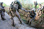 U.S. Marines from Company L, 3rd Battalion, 6th Marine Regiment cross an irrigation ditch during a three-day mission in Marjah, Afghanistan. March 10, 2010. DREW BROWN/STARS AND STRIPES