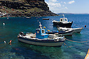Santorini, Greece. 06.05.2014. Small fishing boats in the harbour at Ammoudi, which is at the foot of the cliffs, below the town of Oia at the northern tip of the island. Photograph © Jane Hobson.