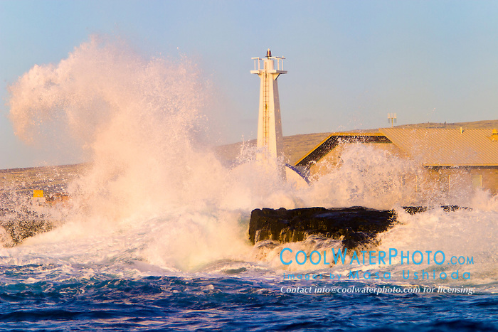 big ocean waves, pounding on lava rocks and lighthouse at Keahole Point, NELHA Facility behind, Kona Coast, Big Island, Hawaii, USA, Pacific Ocean