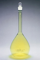 HALOGENS<br /> Chlorine in Volumetric Flask.<br /> Chlorine (Cl2) is a greenish yellow gas at room temperature