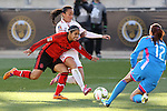 26 October 2014: Arin King (TRI) (5) is defended by Kenti Robles (MEX) (13) and Pamela Tajonar (MEX) (12). The Trinidad & Tobago Women's National Team played the Mexico Women's National Team at PPL Park in Chester, Pennsylvania in the 2014 CONCACAF Women's Championship Third Place game. Mexico won the game 4-2 after extra time. With the win, Mexico qualified for next year's Women's World Cup in Canada and Trinidad & Tobago face playoff for spot against Ecuador.
