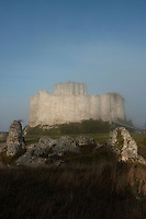 LES ANDELEYS, FRANCE - OCTOBER 10: View of the remains of the outer wall with the embossed ramparts and the keep of the Chateau Gaillard in a fog, on October 10, 2008 in Les Andelys, Normandy, France. The chateau was built by Richard the Lionheart in 1196, came under French control in 1204 following a siege in 1203. It was later destroyed by Henry IV in 1603 and classified as Monuments Historiques in 1852. (Photo by Manuel Cohen)