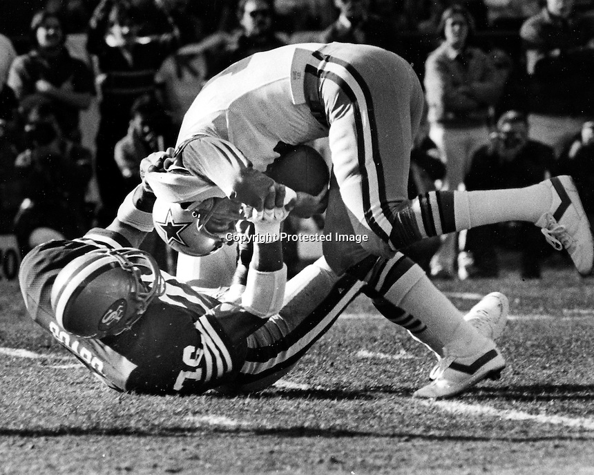 San Francisco 49er defensive end Dwaine Board sacks Dallas Cowboy quarterback. (1981 photo by Ron Riesterer)