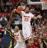 Ohio State Buckeyes center Amir Williams (23) blocks a shot by Michigan Wolverines guard Tim Hardaway Jr. (10) in first half action at Value City Arena on January 13, 2012.  (Chris Russell/The Columbus Dispatch)