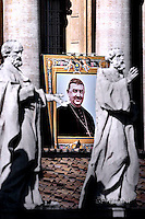 """A tapestry hanged on the facade of St Peter's basilica shows a portrait of Spain's Bishop Manuel Gonzalez Garcia during a canonization mass .Pope Francis  leads a canonization mass on October 16, 2016 at St Peter's square in Vatican. Pope Francis canonises Argentine """"gaucho priest"""" Jose Gabriel Brochero today along with six others raised to sainthood : Salomon Leclercq, Jose Sanchez del Río, Manuel Gonzalez Garcia, Lodovico Pavoni, Alfonso Maria Fusco and Elizabeth of the Trinity."""