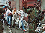 1/29/99 Al Diaz/Herald staff--To quell rioting Colombian military police try to maintain order by forcing people to lock arms together on their way to the food distribution point in Armenia, Colombia. Tens of thousands of Colombians are left homeless after Mondays devastating earthquake.