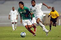 Pix:Simon Wilkinson/SWpix.com. First Islamic Solidarity Games, Jeddah, Saudi Arabia. Football, Saudi Arabia v Palestine 13/04/05...COPYRIGHT PICTURE>>SIMON WILKINSON>>01943 608782>>..The Palestinian soccer team. Palestines Bruno  Rojas and Saudi Arabia  Saleh Dosari