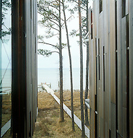 A stretch of decking leads from the house to the jetty overlooking Chesapeake Bay