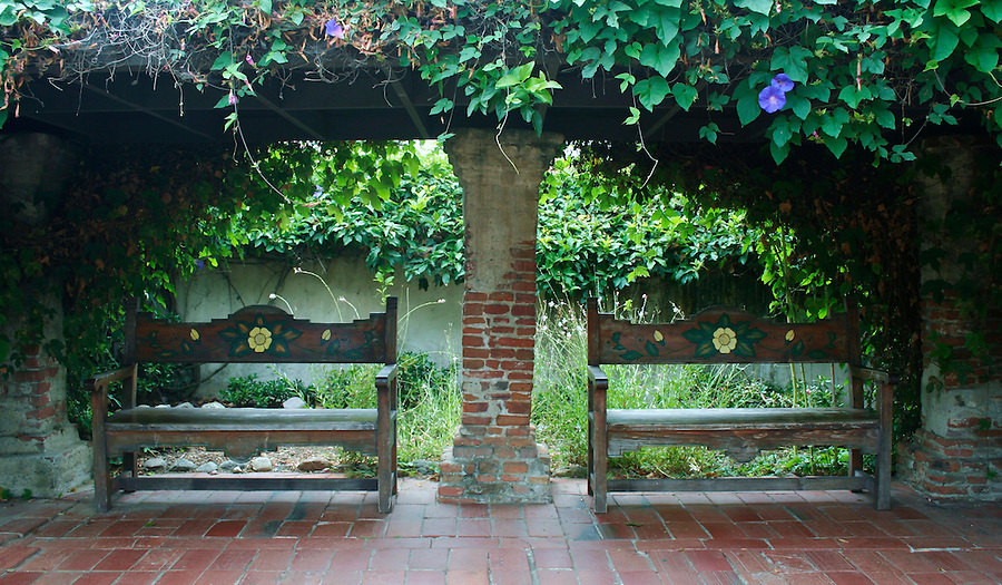 Two benches in the garden at mission at San Juan Capistrano California