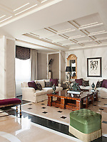 The sitting room of a luxurious apartment. Walls covered in marbleised hand painted paper and a polished floor creates an atmosphere where classic and modern elements coexist comfortably in a totally contemporary space.