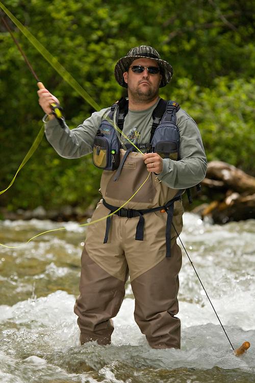 Man fly fishing in the Rio Hondo, near Taos, New Mexico