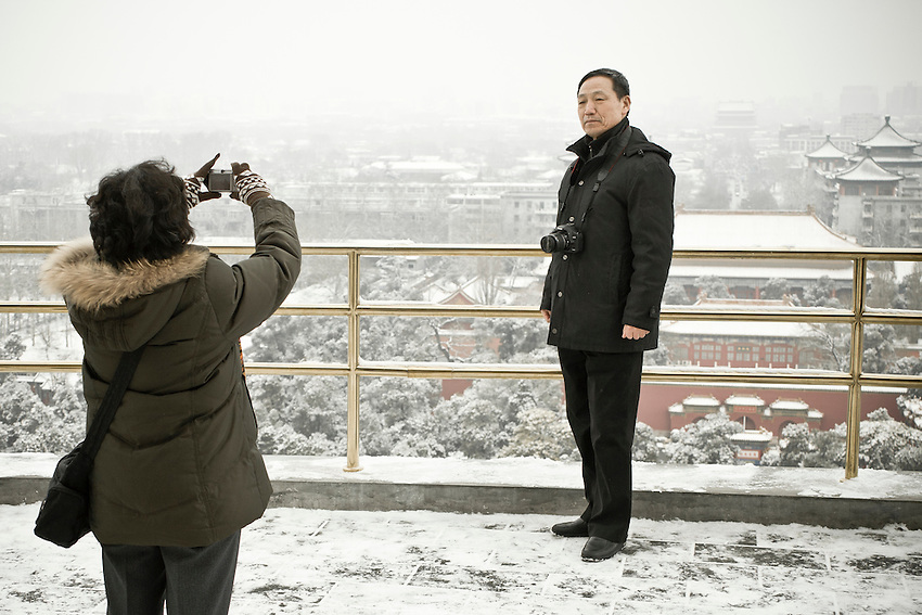 A man is posing for the photo on the Coal Hill (Jingshan park)with the north of Beijing in backgroung  after a snowfall that local authorities say they have artifically provoked to fight the exceptional drought in northern China. Snowfalls of feb. 10 and 13 2011 were the latest in winter since 60 years.