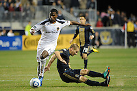 Jordan Harvey (2) of the Philadelphia Union and Edson Buddle (14) of the Los Angeles Galaxy battle for the ball. The Los Angeles Galaxy defeated the Philadelphia Union  1-0 during a Major League Soccer (MLS) match at PPL Park in Chester, PA, on October 07, 2010.