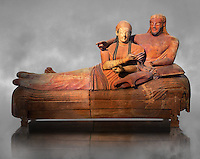6th century BC Etruscan Sarcophagus known as The Sarcophagus of the Spouses, the in sculpted in clay by the sculptors of Caere, 520-510 BC, Louvre Museum, Paris.   Grey art Background. To license for non editorial Advertising usage contact The Louvre Paris