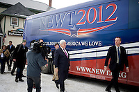 Led by security and followed by the media, former Speaker of the House Newt Gingrich returns to his campaign bus after a town hall meeting in Lancaster, New Hampshire.  Gingrich is seeking the 2012 Republican nomination for president.