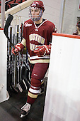 Brian Dumoulin (BC - 2) heads to the ice for warmups. - The visiting Boston College Eagles defeated the Boston University Terriers 3-2 to sweep their Hockey East series on Friday, January 21, 2011, at Agganis Arena in Boston, Massachusetts.