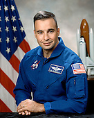 Houston, TX - (FILE) -- File photo from October 6, 1998 of Astronaut Lee J. Archambault, commander, STS-119, scheduled for launch no earlier than February 27, 2009.  Space shuttle Discovery will deliver the International Space Station's fourth and final set of solar arrays, completing the station's backbone, or truss structure.  The arrays will provide enough electricity to power science experiments and support the station's expanded crew of six. Altogether, the station's arrays can generate about 120 kilowatts of usable electricity -- enough to provide about 42 2,800-square-foot homes with power. The 14-day flight will include four spacewalks, lasting about 6.5 hours each, to help install the S6 truss segment to the right side of the station. STS-119 is the 125th space shuttle flight, the 28th flight to the station, the 36th flight of Discovery, and the first flight in 2009..Credit: NASA via CNP
