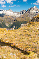 Harris Saddle with shelter on Routeburn Track and Darran Mountains of Fiordland in background, Mt. Aspiring National Park, UNESCO World Heritage Area, Central Otago, New Zealand, NZ