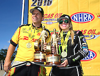Aug 21, 2016; Brainerd, MN, USA; NHRA funny car driver Del Worsham and top fuel driver Brittany Force celebrate after winning the Lucas Oil Nationals at Brainerd International Raceway. Mandatory Credit: Mark J. Rebilas-USA TODAY Sports