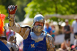 Knights jousting on horseback and fighting in sword fight duels at a re-enactment,using authentic weaponry and armour, at Arundel Castle, Sussex, UK.