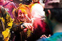 A woman throws colored powder to her friends as she attends the Holi Hai festival organized by Indian community in New York City March 31, 2013. Photo by Eduardo Munoz Alvarez / VIEWpress.