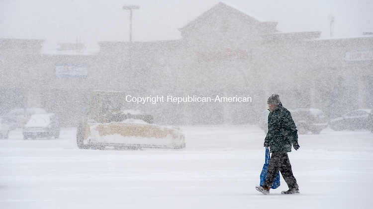 TORRINGTON, CT-021314JS07- A person makes their way through the heavy snow during Thursday's snowstorm that rolled through the area. <br /> Jim Shannon Republican-American