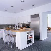 The kitchen has bespoke units, island and worktops which were all designed by Deborah Berke