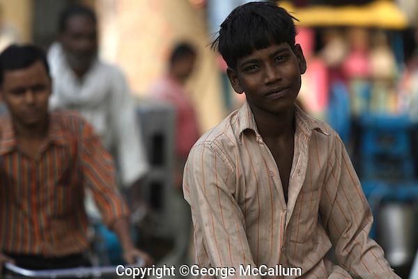 Young indian boy on bicycle, Varanasi, Uttar Pradesh, India