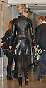 """May 8, 2012, Narita, Japan - Lady Gaga, sporting a leather coat and her rainbow-colored hair, arrives at Narita Airport, east of Tokyo, on Tuesday, May 8, 2012. ..The American pop singer and song writer was in Japan on a """"Lady Gaga/The Born This Way Ball"""" world tour. It was her sixth visit to Japan where a teacup and saucer, marked with her lipstick and bearing the Japanese message We pray for Japan along with the stars autograph, has fetched more than $75,000 at auction.(Photo by Natsuki Sakai/AFLO) AYF -mis-."""