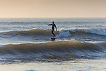 Surfers at Compton Bay on the Isle of Wight during an Autumn swell 2015.
