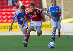 St Johnstone v Aberdeen....18.08.12   SPL.Mitch Megginson is fouled by Paddy Cregg.Picture by Graeme Hart..Copyright Perthshire Picture Agency.Tel: 01738 623350  Mobile: 07990 594431