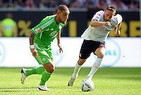 FUSSBALL   1. BUNDESLIGA   SAISON 2011/2012    2. SPIELTAG VfL Wolfsburg - FC Bayern Muenchen      13.08.2011 Ashkan DEJAGAH (li, Wolfsburg) gegen Franck RIBERY (re, Bayern)