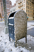 USPS postal collection letterbox encrusted with grimy snow from a recent snowfall is seen in the New York neighborhood of Chelsea on Sunday, January 22, 2012. Less than a year after a postage rate to 44 cents, first class mail has gone up to 45 cents. (© Richard B. Levine)