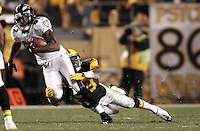PITTSBURGH, PA - NOVEMBER 06: Torrey Smith #82 of the Baltimore Ravens attempts to break a tackle by the Pittsburgh Steelers defense after catching a pass during the game on November 6, 2011 at Heinz Field in Pittsburgh, Pennsylvania.  (Photo by Jared Wickerham/Getty Images)
