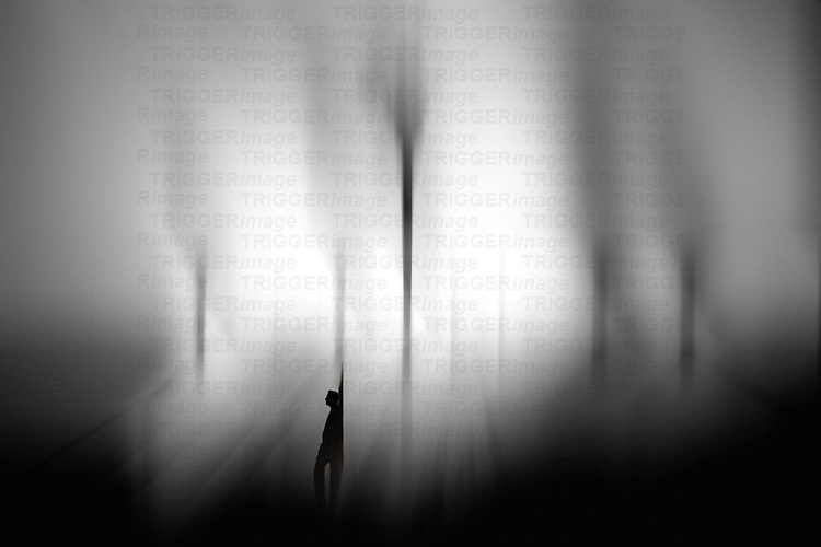Silhouetted male figure alone in backlit scene