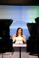 A news reader prepares herself before going on air at news channel Al Jazeera in Doha.