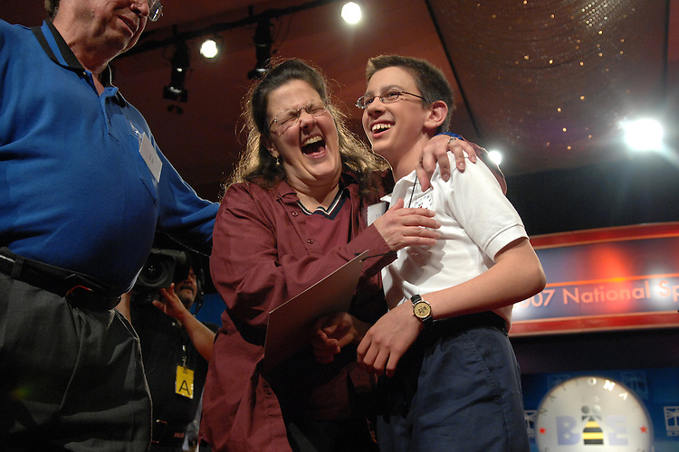 """Evan M. O'Dorney, 13, of Danville, Cailf., gets a hug from his mother Jennifer as his father Michael, looks on, after Evan won the 2007 Scripps National Spelling Bee with on the word """"serrefine,"""" Thursday night at the Grand Hyatt."""