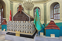 Tomb of Sultan Osman Gazi, 1258-1326, founder of the Ottoman dynasty, Bursa, Turkey. During the siege of Bursa, Osman Gazi indicated to his son Orhan Gazi a domed structure within the city and asked to be buried there. This Byzantine structure later became a mosque and was destroyed in the earthquake of 1855. A new tomb has since been built. The sarcaophagus is of wood inlaid with mother of pearl and is surrounded by the sarcophagi of Savci Bey son of sultan Murad I, Alaaddin Bey son of Orhan Gazi, Aspuce Hatun wife of Orhan Gazi and Ibrahim Bey son of Orhan Gazi and 12 unidentified sarcophagi. Picture by Manuel Cohen