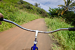 Bicycling along a bike path in Kapa'a, Kauai, Hawaii