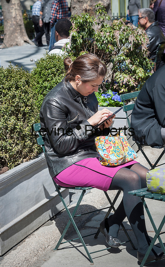 A woman uses her tablet computer in Bryant Park in New York City during her lunch hour on Thursday, April 3, 2014.  Temperatures are expected to rise into the mid 60's with plenty of sun today and Friday but clouds and a chance of showers arrive over the weekend.  (© Richard B. Levine)