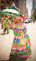 Costumed performer from Grupo Carnavelsco de Santiago en NJ in  the 32nd Annual Dominican Day Parade in New York on Sixth Avenue on Sunday, August 10, 2014.  Politicians, flags and cultural pride were on display at the annual event. Over 6o0,000 people identifying themselves as as Dominicans live in the New York area and with beautiful weather it seem like almost all of them were on Sixth Avenue. (© Richard B. Levine)