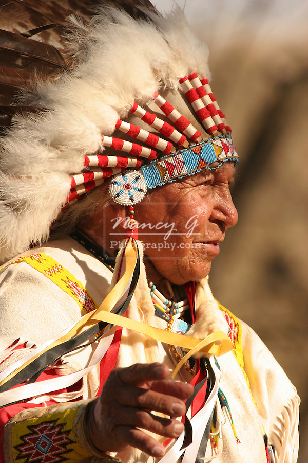 A Native American Sioux Indian telling a story outside in Fall