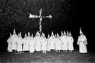 Dunham Springs, LA- December 11, 1976<br /> The members of the local Ku Klux Klan gather at a monthly evening ceremony. Wearing white hoods they circle their traditional cross on fire. <br /> Dunham Springs, Louisiane. 11 d&eacute;cembre 1976.<br /> Le Ku Klux Klan, m'a invit&eacute; &agrave; assister &agrave; la c&eacute;r&eacute;monie mensuelle o&ugrave; ils br&ucirc;lent une croix pour symboliser leur: &ldquo;Vigilance pour la protection de la race blanche.&ldquo;