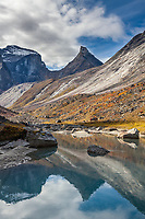 Arial peak reflects in Arrigetch creek, Gates of the Arctic National Park, Alaska.