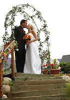 Cyril and Chelsea kiss at their outdoor wedding ceremony.  Private residence, Sandy (near Salt Lake City), Utah...Photo &copy; http://gsilvaphoto.com