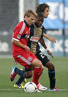 CHESTER, PA - AUGUST 12, 2012:  Raymon Gaddis (28) of the Philadelphia Union marks  Chris Rolfe (18) of the Chicago Fire during an MLS match at PPL Park, in Chester, PA on August 12. Fire won 3-1.