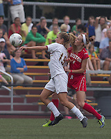 Boston College midfielder Kristen Mewis (19) controls the ball as Boston University defender Erin Mullen (7) pressures. After 2 complete overtime periods, Boston College tied Boston University, 1-1, after 2 overtime periods at Newton Soccer Field, August 19, 2011.